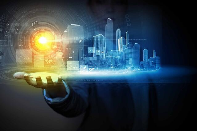 Businessperson holding media image of city in palm. New technologies.jpeg