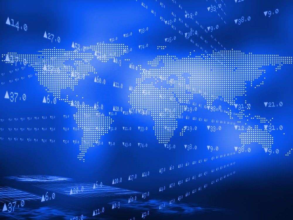 Stock prices lining above world map on blue background.jpeg